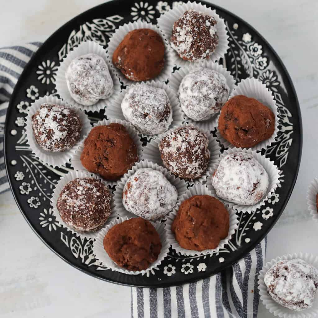 low carb rum balls covered in coconut, powdered erythrtitol, and cocoa powder