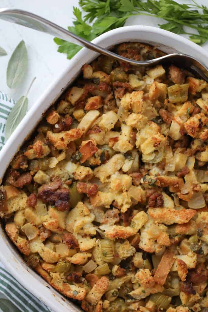sausage apple and sage stuffing in a 9x13 pan for Thanksgiving