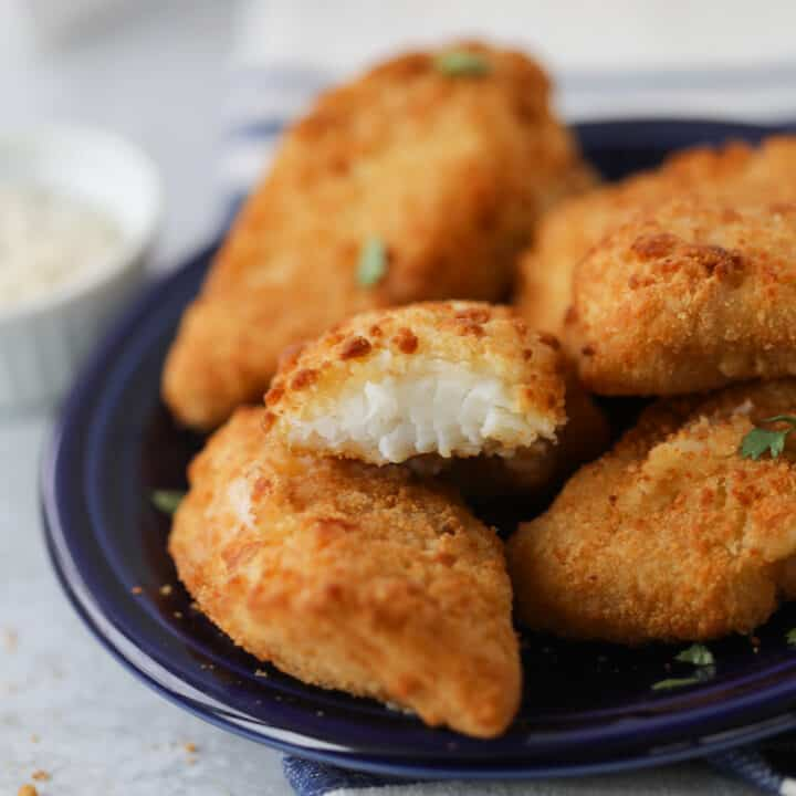 the frozen fish in air fryer recipe with a bite out of a piece after cooking