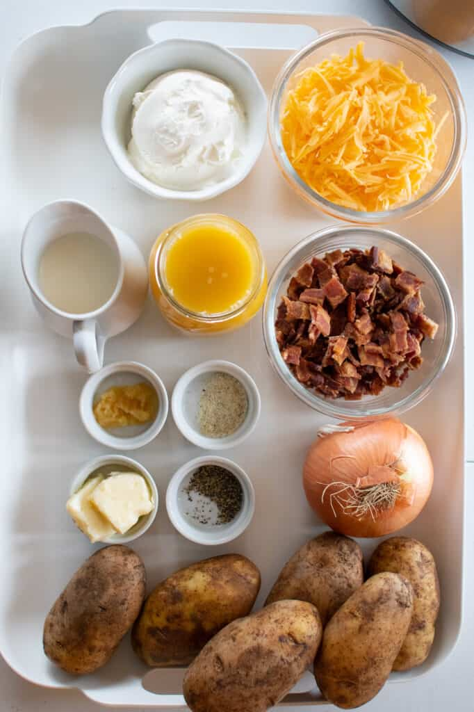 instant pot baked potato soup ingredients on a white tray