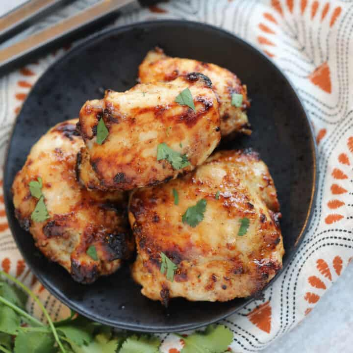 air fryer frozen chicken thighs with a honey mustard glaze with garnishes