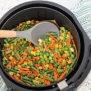 air fryer frozen vegetables medley getting stirred