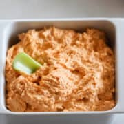 the buffalo chicken dip keto recipe in a white dish