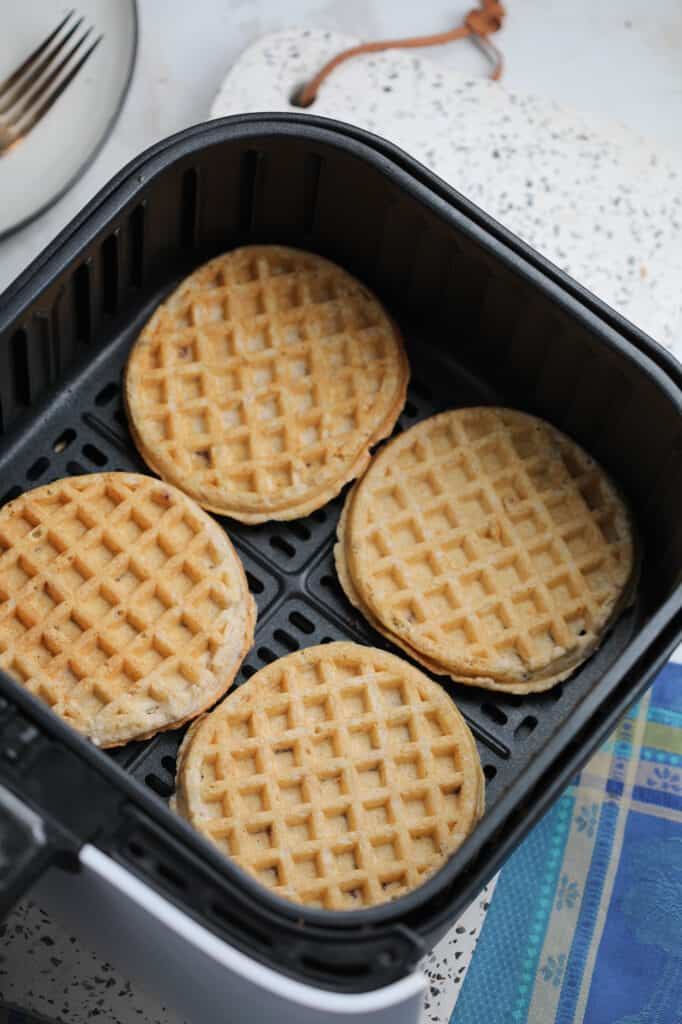 cooking air fryer waffles starts by laying them out in a single layer