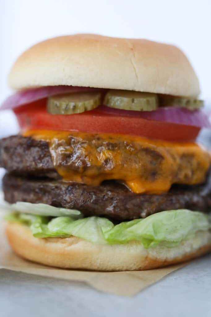 frozen burgers in air fryer recipe loaded with toppings on a bun