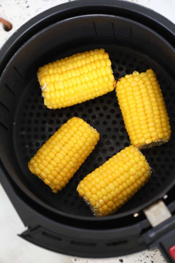 frozen corn on the cob air fryer recipe after cooking resting in the air fryer