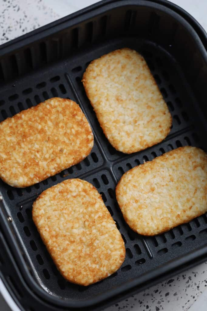 lay the frozen hash browns air fryer patties spread out in the basket