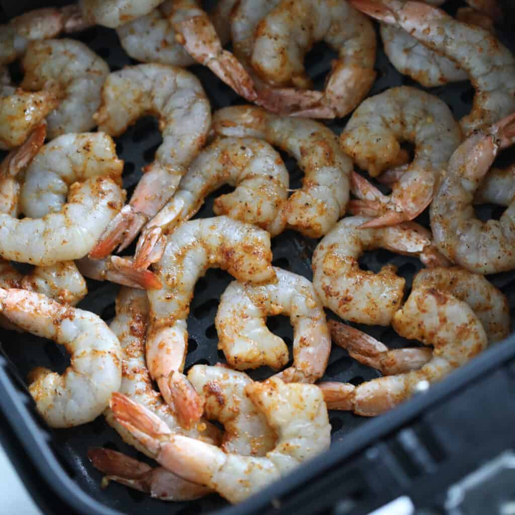 the healthy air fryer shrimp after cooking for 1 minute