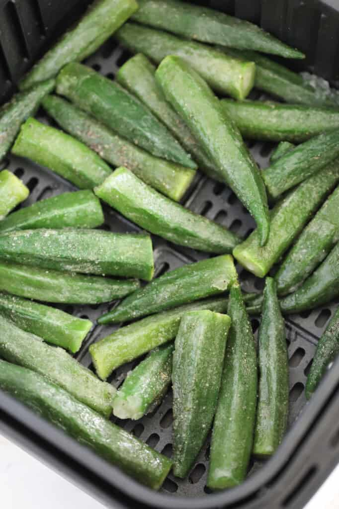 how to cook frozen okra in the air fryer starts with adding the okra to a preheated basket