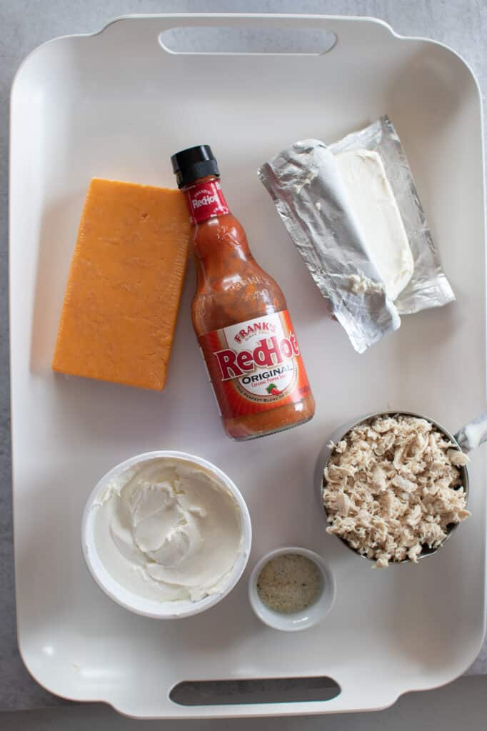 keto buffalo chicken dip ingredients on a white tray