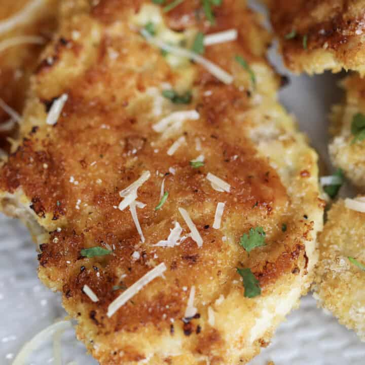 breaded and baked chicken cutlets in oven close up photo after cooking