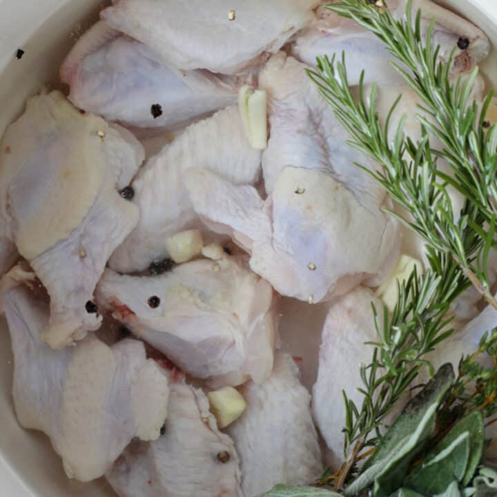 easy chicken wing brine recipe in a large white pot