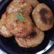 sausage patties in oven up close on a plate after cooking
