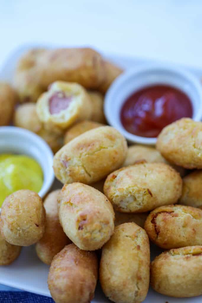 air fryer mini corn dogs on a white plate with mustard