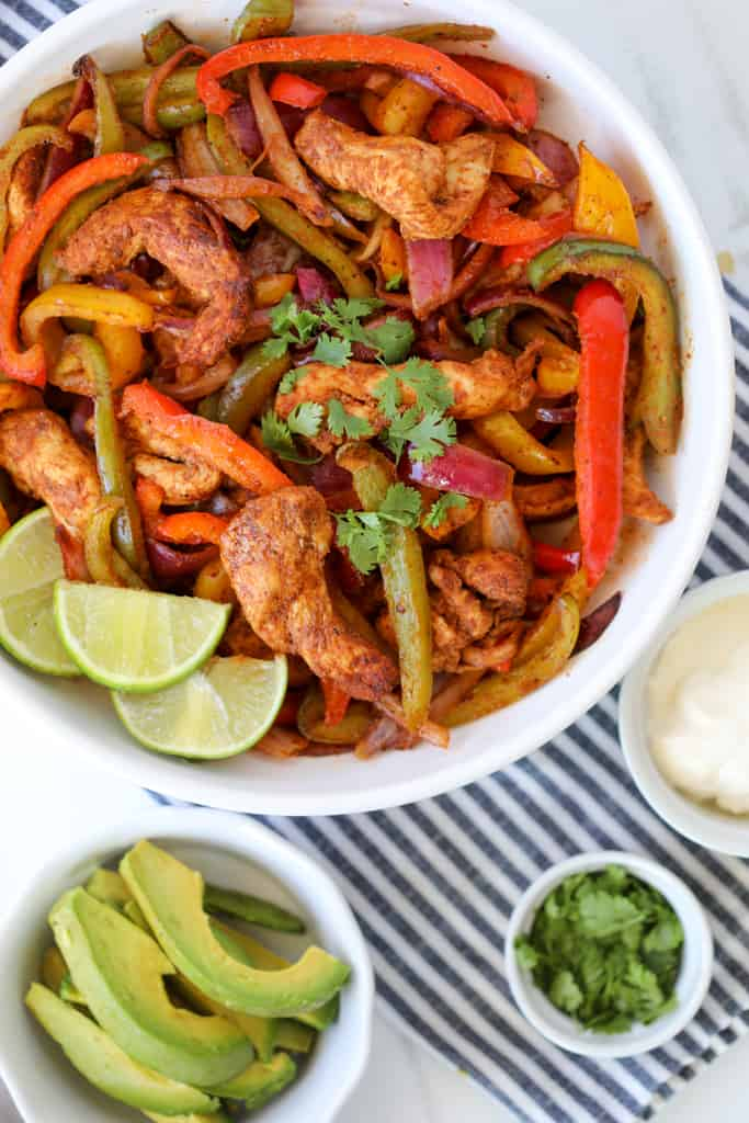 air fryer chicken fajitas after cooking in a white bowl