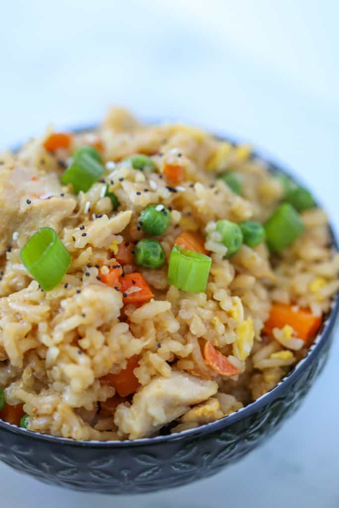 air fryer chicken fried rice in a black bowl