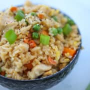 chicken fried rice air fryer recipe with garnish in a bowl