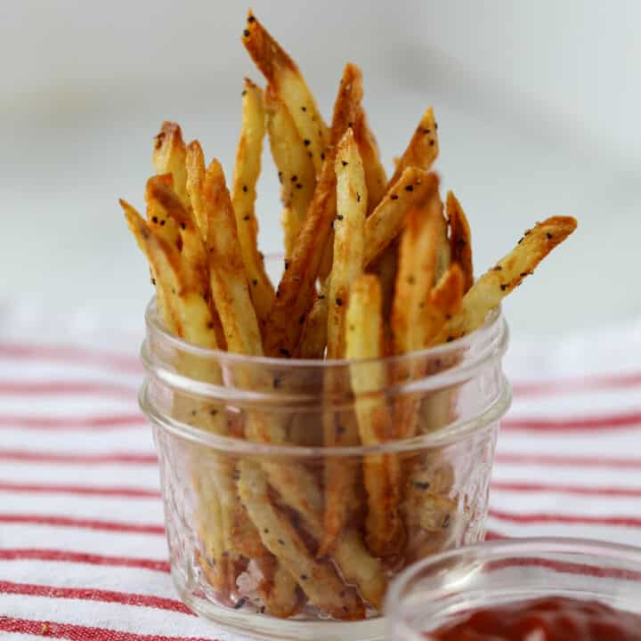french fries in air fryer in a mason jar standing up