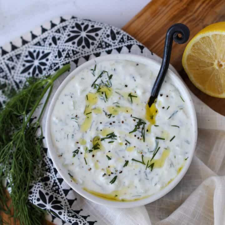 low fat tzatziki sauce using fat free Greek yogurt in a bowl drizzled with olive oil