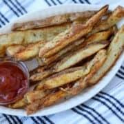 crispy steak fries in air fryer with seasoning and ketchup