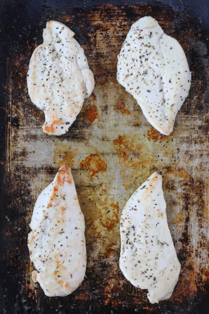 bake the thin chicken breast in oven on a sheetpan