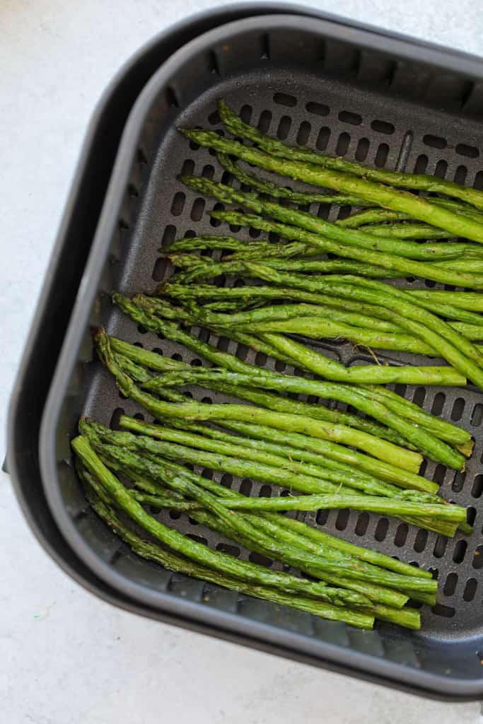 roasted air fryer frozen asparagus in the air fryer basket