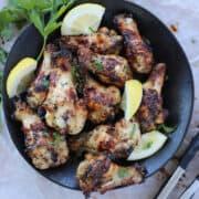 air fryer lemon pepper wings with lemon wedges