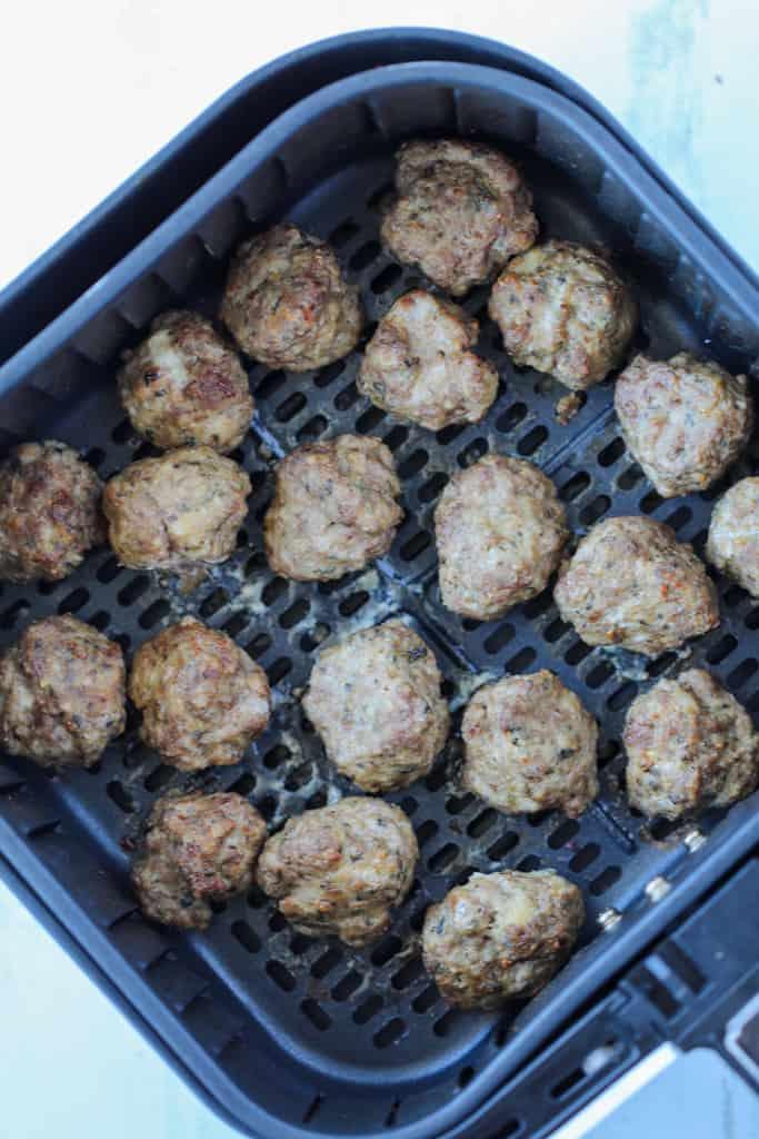 cooking meatballs in air fryer in the air fryer basket