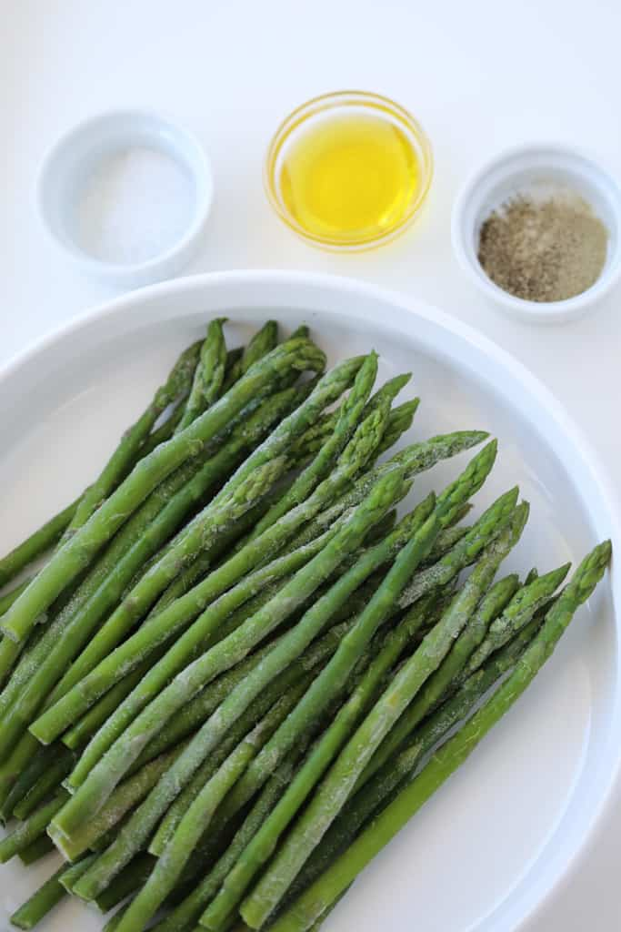 roasted frozen asparagus air fryer recipe ingredients on a white tray