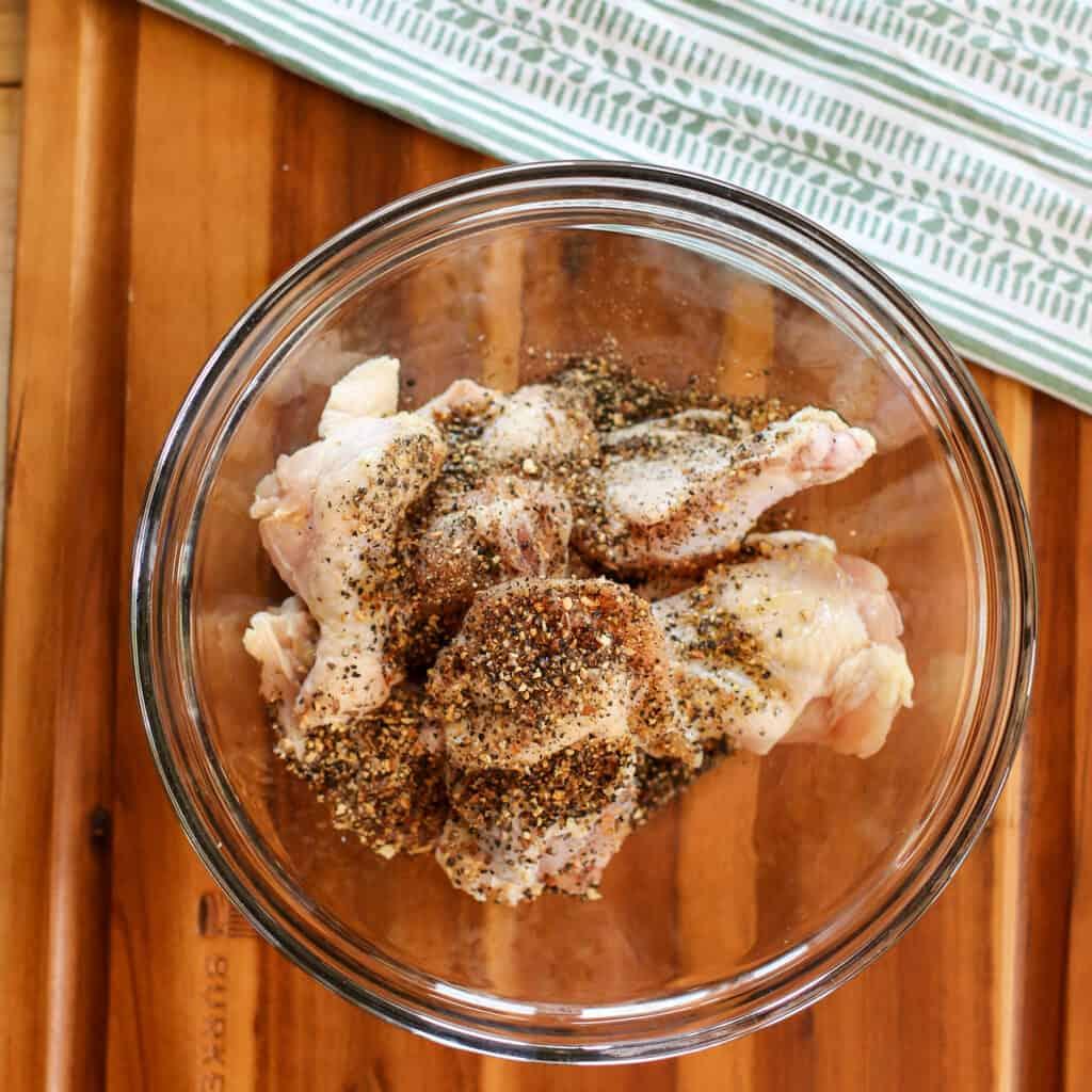 lemon pepper wings in air fryer ingredients in a bowl to mix