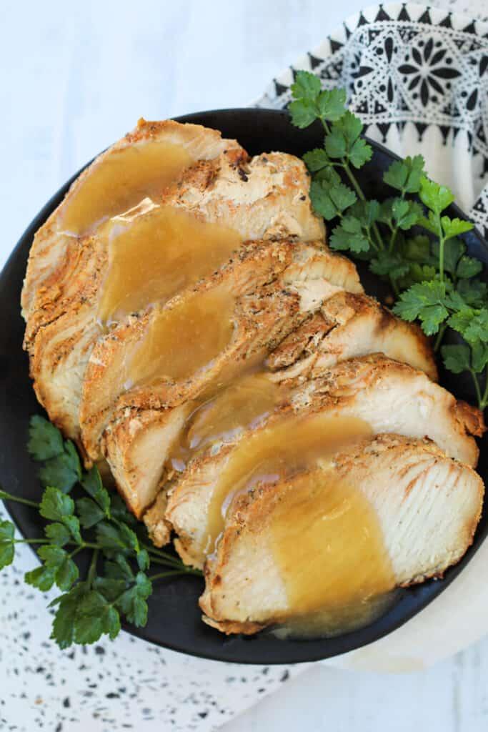 air fryer boneless turkey breast roast with gravy on a serving plate