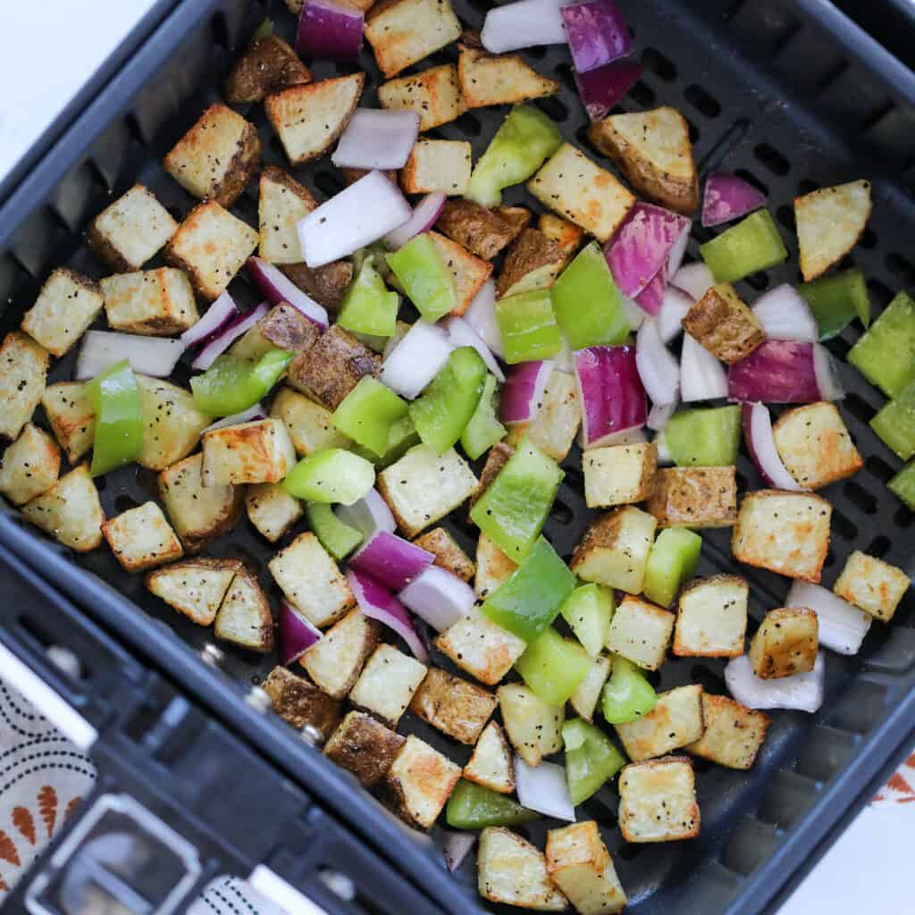 homemade air fryer home fries with bell peppers after cooking