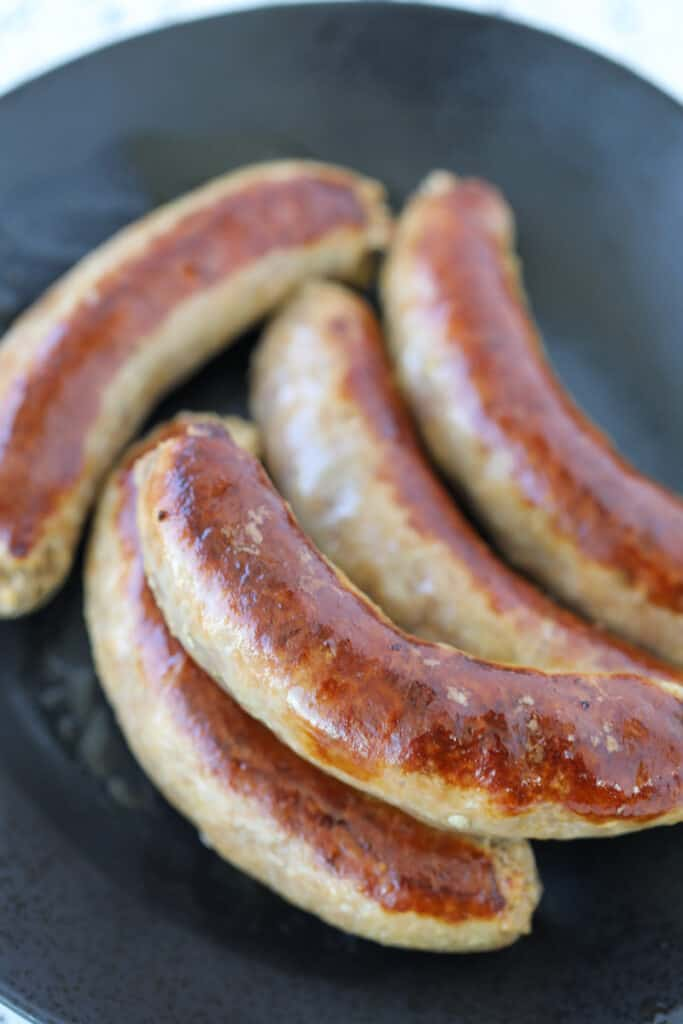instant pot Italian sausage on a black plate after pressure cooking