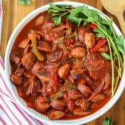 slow cooked kielbasa in a white bowl after cooking in a crockpot