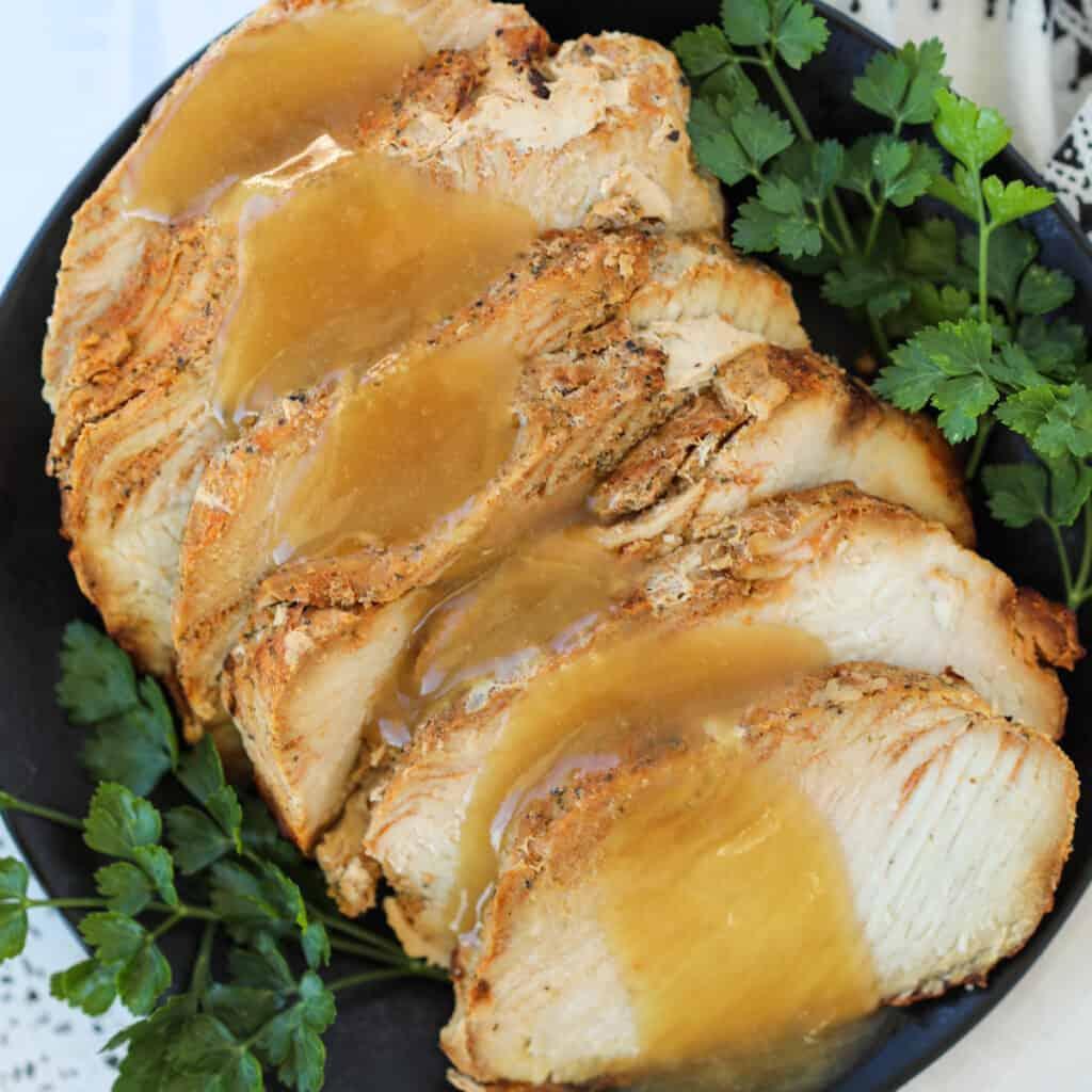 boneless turkey breast in air fryer sliced on a serving plate